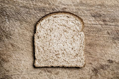 Wholemeal bread. A slice of wholemeal bread on a table Royalty Free Stock Image