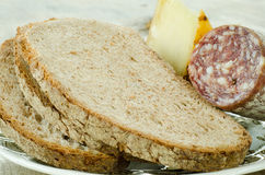Wholemeal bread and appetizers Royalty Free Stock Photo