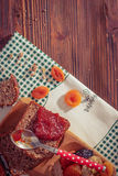 Wholemeal bread with apricot jam Stock Images
