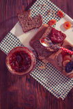 Wholemeal bread with apricot jam Stock Photography