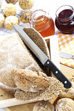 Wholemeal bread, bread rolls,honey and jam Royalty Free Stock Photography