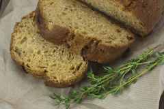 Wholemeal bread on brown paper Stock Photography