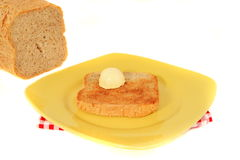 Wholemeal bread with butter Stock Photos
