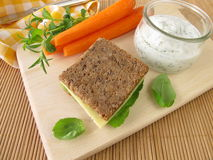 Wholemeal bread and carrots with yogurt dip Royalty Free Stock Photography
