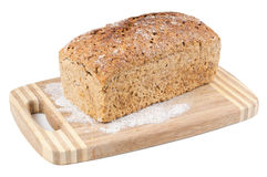 Wholemeal bread on a chopping board Stock Photos