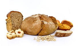 Wholemeal bread and cookies. Wholemeal bread, pastry, cookies on white Royalty Free Stock Photos