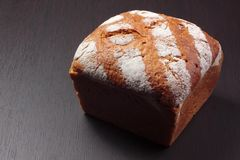 Wholemeal bread on dark board Stock Images