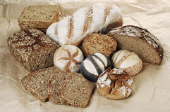 Wholemeal bread. Different sorts of wholemeal breads and rolls, selective focus Stock Photography