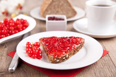 Wholemeal bread with jam and coffee Stock Images