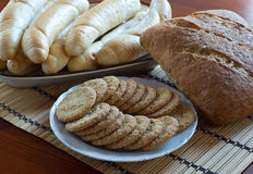 Wholemeal bread, rolls and biscuits Stock Images