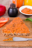 Wholemeal bread with a selfmade vegetarian spread. Picture of a wholemeal bread with a selfmade vegetarian spread Stock Photo