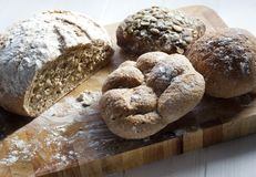 A selection of rustic rolls and bread stock photo