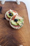 Wholemeal bread snack. With cheese, avocado, olive, tomato and greens Stock Photography