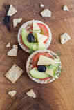 Wholemeal bread snack. With cheese, avocado, olive, tomato and greens Stock Photos