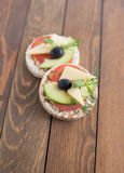 Wholemeal bread snack. With cheese, avocado, olive, tomato and greens Royalty Free Stock Photo