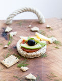 Wholemeal bread snack. With cheese, avocado, olive, tomato and greens Royalty Free Stock Images