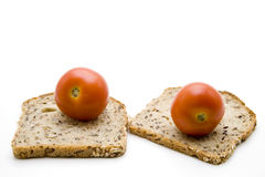 Wholemeal bread and tomatoes Stock Image