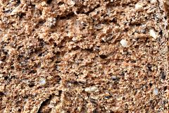 Wholemeal brown bread with seeds sliced. Macro texture. stock photos