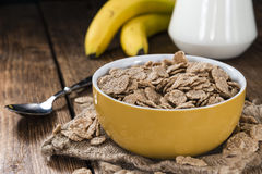 Wholemeal Cornflakes. (in a bowl) on wooden background Stock Images