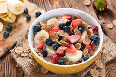 Wholemeal Cornflakes with fresh Fruits Royalty Free Stock Photography