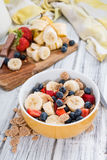 Wholemeal Cornflakes with fresh Fruits Stock Images