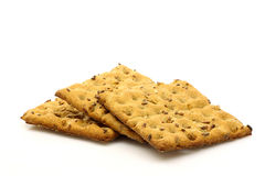 Wholemeal crackers. Freshly baked wholemeal crackers on a white background Royalty Free Stock Image