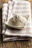 Wholemeal flour in ceramic bowl Stock Photo
