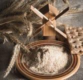 Wholemeal flour and wheat on cloth sack Royalty Free Stock Photos