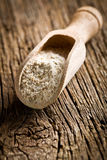 Wholemeal flour in wooden scoop Stock Photo