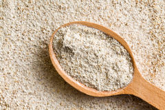 Wholemeal flour in wooden spoon Stock Photos