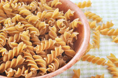 Wholemeal fusilli italian pasta Stock Photos