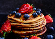 Wholemeal Pancakes with Berries. Stack of Wholemeal Pancakes with Berries royalty free stock photo