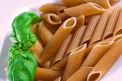 Wholemeal pasta. With fresh basil Stock Images