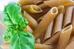 Wholemeal pasta. With fresh basil Stock Photo