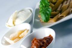 Wholemeal pasta. With fresh basil, tomato souce, mozzarella, parmesan Stock Photos