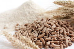 Wholemeal pasta and flour  macro Royalty Free Stock Images