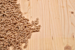 Wholemeal pasta fusilli from organic whole grain spelt on a rust Royalty Free Stock Photo