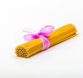 Wholemeal pasta. Package of spaghetti on white background. Wholemeal pasta Stock Photography