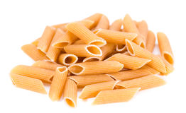 Wholemeal Pasta (Penne) over white Stock Photography