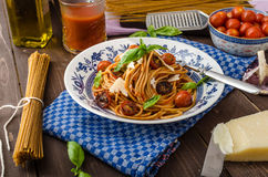 Wholemeal pasta with roasted tomato. And garlic, homemade tomato salsa Stock Photos