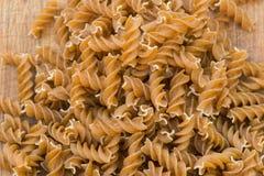 Wholemeal raw fusilli pasta. Closeup stock photo