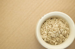 Wholemeal rice grains in a cup Royalty Free Stock Image