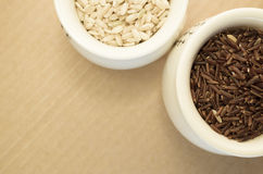 Wholemeal rice grains in a cup Royalty Free Stock Images