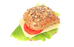 Wholemeal roll with cheese Royalty Free Stock Images