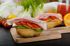 Wholemeal roll with prague ham Stock Images