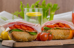 Wholemeal roll with prague ham Royalty Free Stock Image