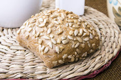 Wholemeal roll with seeds Stock Photos