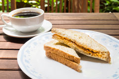 Wholemeal sandwich bread served on plate with black coffee at the background Stock Photos