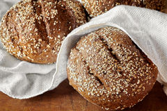 Wholemeal Seeds Bread Loafs. Closeup of wholemeal bread loafs with various seeds Stock Photography