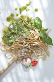 Wholemeal Spaghetti With Basil Pesto And Pine Nuts Stock Images